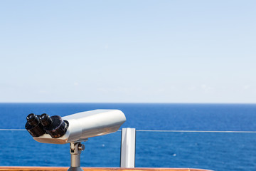 Silver Scope Overlooking Blue Sea