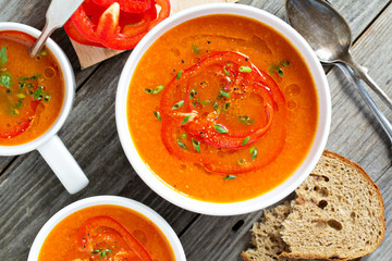 Roasted red pepper soup in white bowl