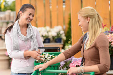 Two smiling woman shopping plants garden center