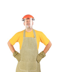 Worker in apron and plastic mask.