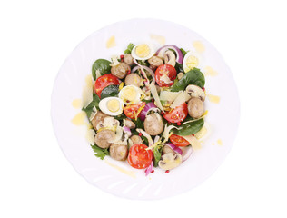 Mushrooms salad with tomatoes and pine nuts.