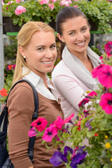 Smiling customer women in garden center