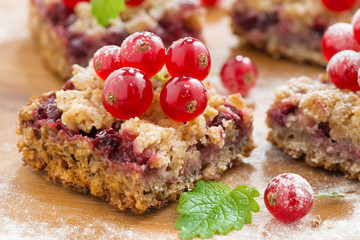 berry tart with fresh red currants on wooden board