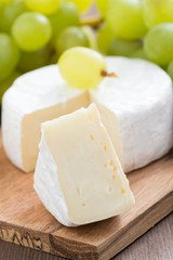 camembert and fresh green grapes, close-up