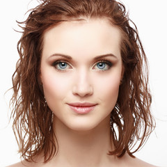 Portrait of beautiful young woman with clean face
