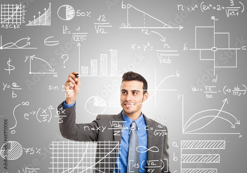Man writing formulas on the screen
