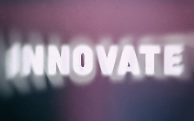 Innovate word on vintage blurred background
