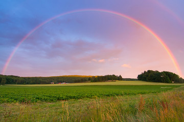 Rainbow over Swedish farm field