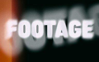 Footage word on vintage blurred background
