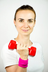 Young woman exercising with dumbbell, isolated