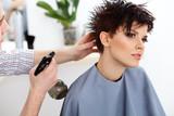 Fototapety Hairdresser doing Hairstyle. Brunette with Short Hair