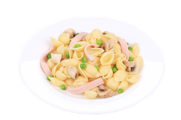 Pasta shells with vegetables on white plate.