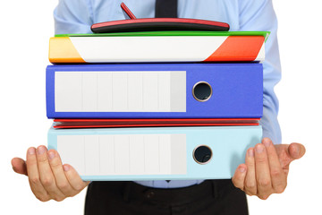 businessman carrying binders