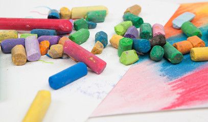stack of multicolored pastel chalks on white background