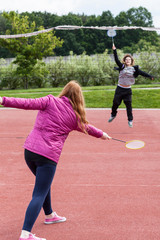 Young girls playing badminton