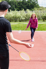 A couple of teenagers training badminton