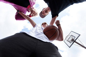 Young people training basketball