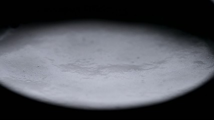 Bubbles in fizzy water - macro footage.