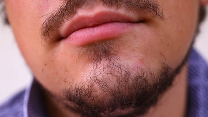 Close up of bearded and tired man. Macro video shift motion