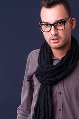 handsome young fashion man wearing scarf - shot in studio