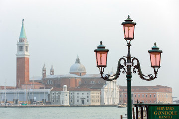 Gondola ride stop and street lamp at Venice waterfront