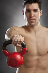 man doing exercises with kettlebell