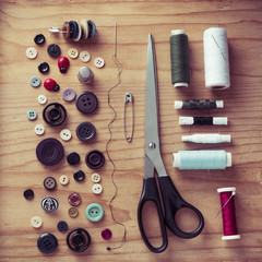 Thread, Button and scissors on the table