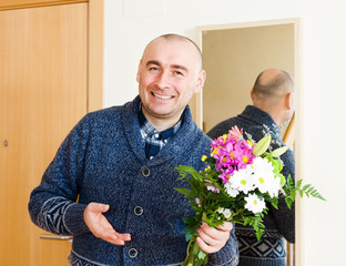 smiling man with  bouquet