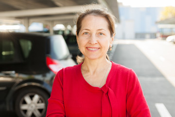 woman   at car parking lot.
