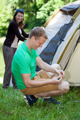 Couple pitching a tent