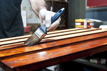 Varnishing wooden boards