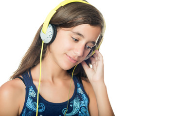 Beautiful hispanic teenager listening to music