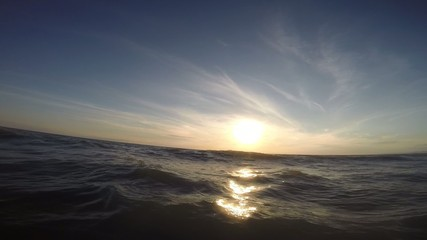 Swimming in the sea at sunset. Point of view shot