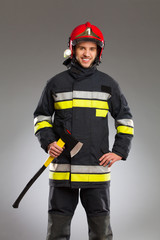 Fireman posing with an axe.