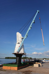 Crane for lowering and lifting the yachts and boats in the water