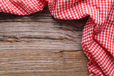 Checkered tablecloth on wooden table
