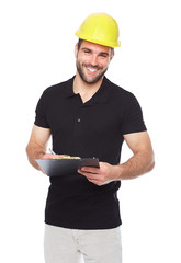 Young smiling engineer writes on a black folder