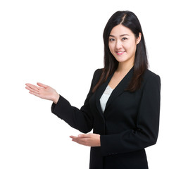Business woman introduce something by hand