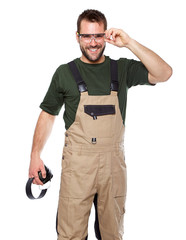 Worker in brown uniform with earphones a glasses