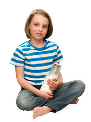 Child  sitting with a bottle of milk.