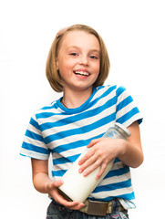 Child with a bottle of milk.