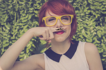 Cute hipster teenage girl with mustache, retro styled imagery