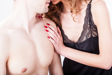 Flirting couple in bedroom
