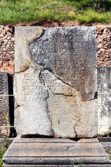 Ancient stone engraving in Delphi Greece