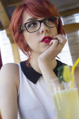 Cute hipster teenage girl daydreaming
