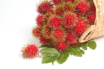 Fresh rambutan with leaf on the basket