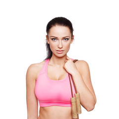 Brunette woman holding jump rope