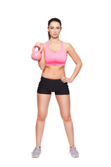 Fit woman holding kettlebell