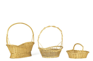 Yellow wicker baskets isolated on white