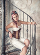 Beautiful steampunk woman on the stairway